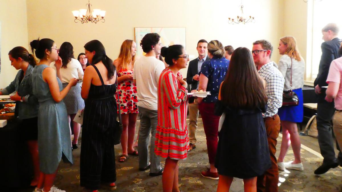 A group of students at the Pi Sigma Alpha Reception